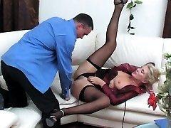 Ebony bi-atch in black fishnet stockings sucks boner
