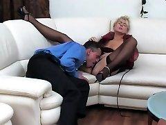 Ebony tramp in ebony fishnet stockings sucks cock
