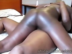 Two dark-hued mama playing chubby humid pussy