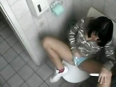 Bimbo chick masturbates on toilet
