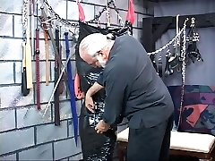 Chunky brown-haired sadism & masochism slave gets wrapped head-to-toe in ebony plastic