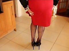 Dark-hued satin blouse with red split pencil microskirt and black FFs