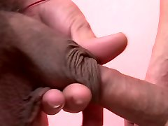 Brunette gay couple enjoy intimate sofa sex sesh