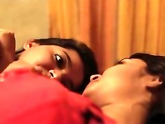 Indian nymphs kissing