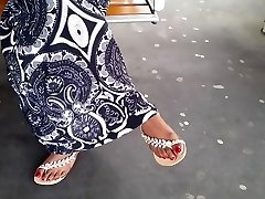Indian mature feet with crimson nails