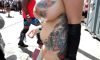 Huge-chested mature exhibitionist with petting in public
