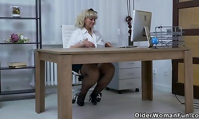 Euro Plumper Dita works her cooch with fingers and dildo