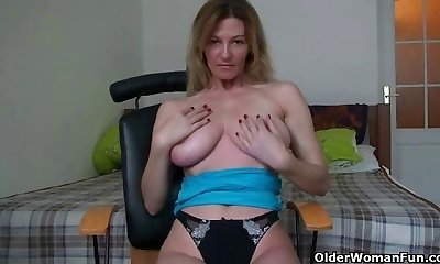 Platinum-blonde soccer mummy shows her big tits and wanton pussy
