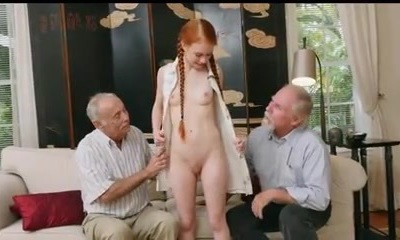 senior men with young redhair babe
