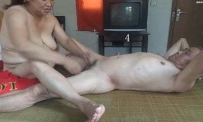 Chinese granny is having fun with granddad