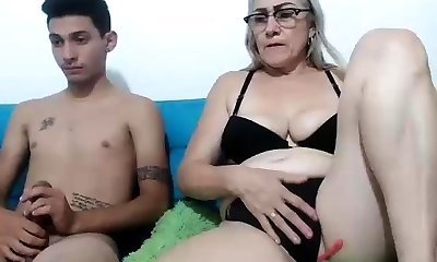 Mature dame and youthfull guy fucking a WebCam