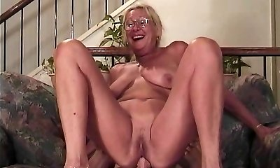 Mature blondie with glasses gargles a cock