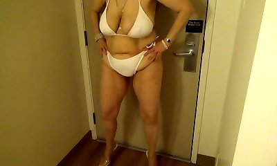 Tinja Stretches A White String Bathing Suit in 6 Inch Stilettos