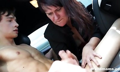 Mature lady hand-job in the car