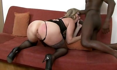 Voluptuous granny with glasses riding a xxl black cock