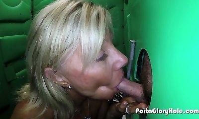 Swallowing cum from strangers inside of public porta potty