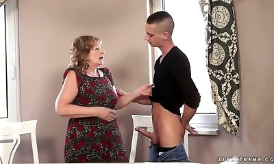Horny grandma Sally G pummels a handsome student on the couch