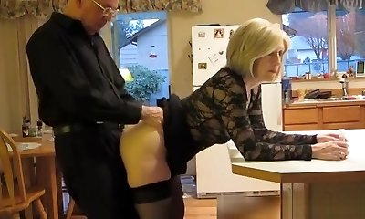 Mature couple pounding in the kitchen