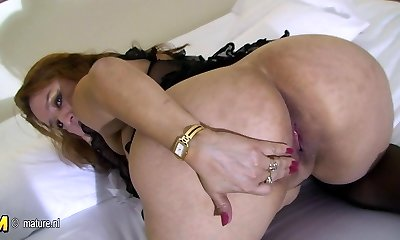 Big mama enjoys to play with her old pussy