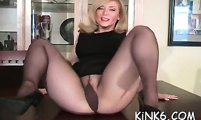 Gracious sex addict exposes hairy twat in see-through tights