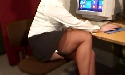 Sexy Tights Teasing Cougar in Busy Office