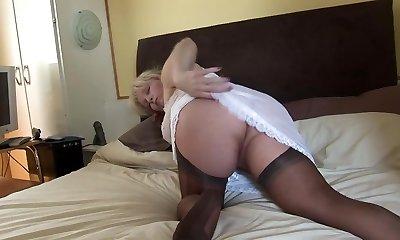Busty mature blondie in sheer pantyhose slip and stockings