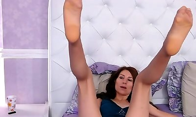 Mature girl plays with sex toys