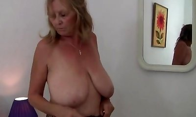 Grannie WITH BIG BREASTS RIPS OPEN HER Stockings
