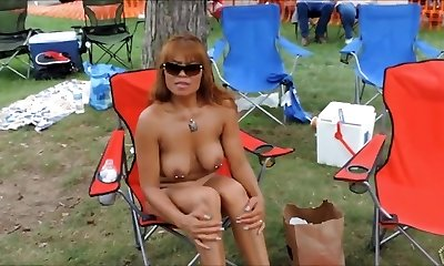 Pierced mature nudists showcase everything off at the resort