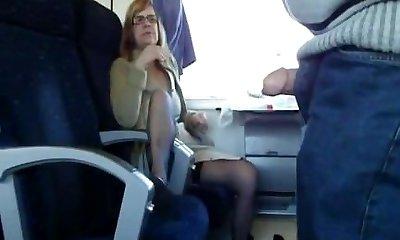 Mature wife sucks in train