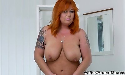 Redhead milf Alex undresses off and fingers her mature cunt