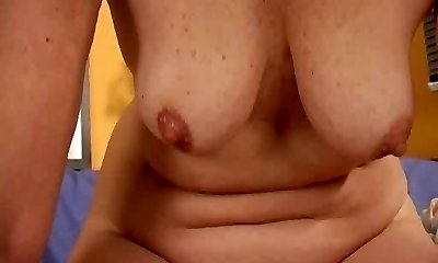 Mature redhead bangs her loose pussy