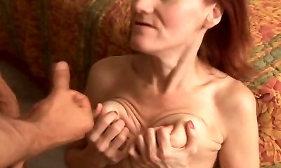 Skinny mature redhead loves to pound and the taste of spunk