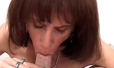 Lean aging slutbag wraps her ugly tits around white cock