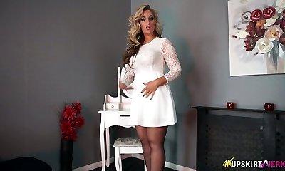 Charming blonde mummy Kellie O Brian flashes what she got under her mini-skirt