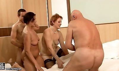 Two gigantic moms make out with their lovers in group sex lovemaking