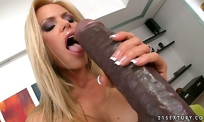 Skanky blond mom gives oral pleasure to huge brown faux-cock