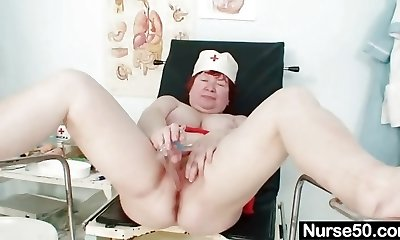Ugly redhead mom fucktoys her unshaved pussy