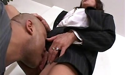 Boss gal evaluates her worker's cock at the office