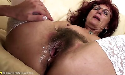 Deep fisting for sexy mature mom's hairy puss