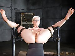 Cherry Torn is a platinum blonde worth more than her weight in gold when it comes to hard bondage and rough sex. She is a cock-crazed slut who will take however many dicks we give her. We've slammed her with one, pounded her with a pair, and this time we're going to completely devastate her with three hard cocks at the same time.