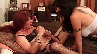 Crossdressing fellow fucked with strap-on