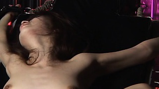 Sexy chick is tied up and fucked by big machine