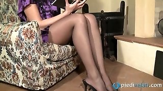 Nasty brunette sweetie Flavia looks irresistible in black nylon tights