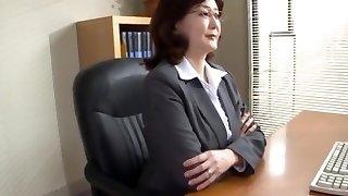 Japanese school director milks in the office