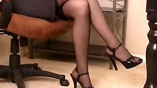Hot brunette bitch in office fake penis pounds and fondles her fuckbox in nylons