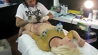 Blonde stupid moans with pain as her pubis was being tatted