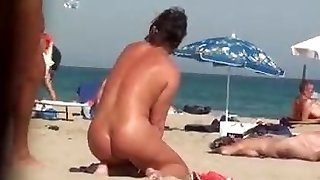 Beach voyeur - she's urinating!