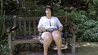 Taking off her g-strings in the park