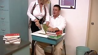 Mature blond with large breasts screwed by schoolgirl in the classroom